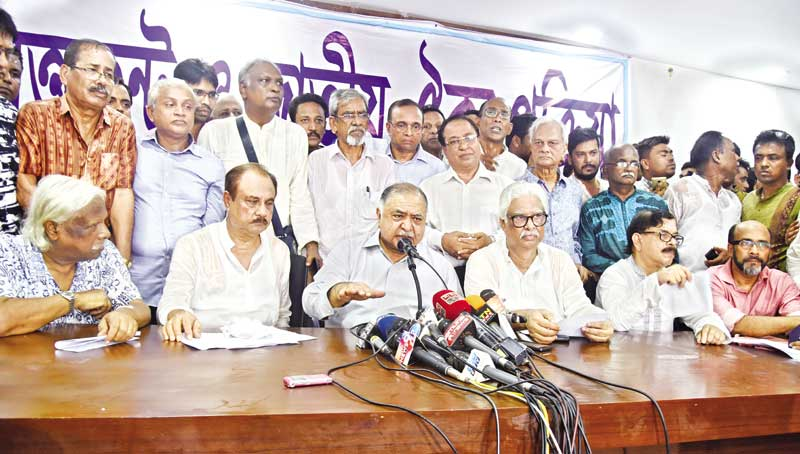 Eminent jurist Dr Kamal Hossian announcing the formation of 'greater national unity' at a press conference at the National Press Club in the capital on Saturday.	photo : Observer