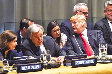 United Nations General Secretary Antonio Guterres (2nd L) talk to his Chef de Cabinet as US President Donald Trump (R) talks to his Press Secretary Sarah Sanders (C) at the opening of the Global Call To Action On The World Drug Problem at the United Nations in New York on September 24.photo : AFP