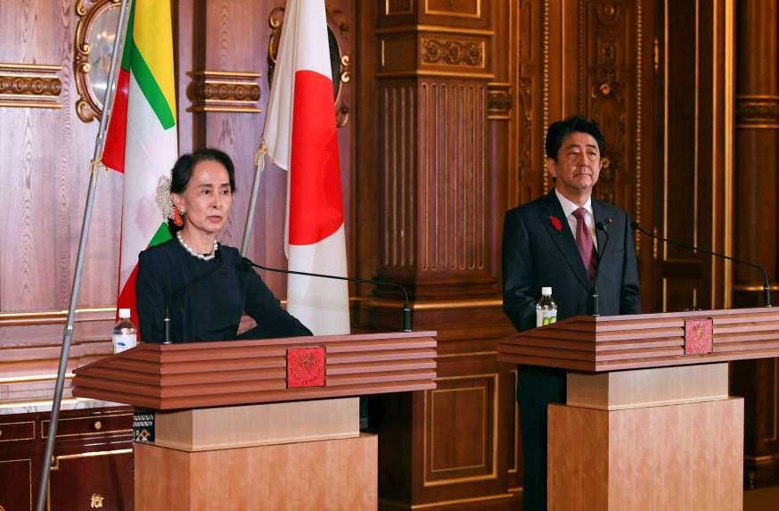 Myanmar's leader Aung San Suu Kyi delivers her speech beside Japanese Prime Minister Shinzo Abe during their joint press remarks following their bilateral meeting at the Akasaka Palace state guest house in Tokyo, Oct. 9, 2018.