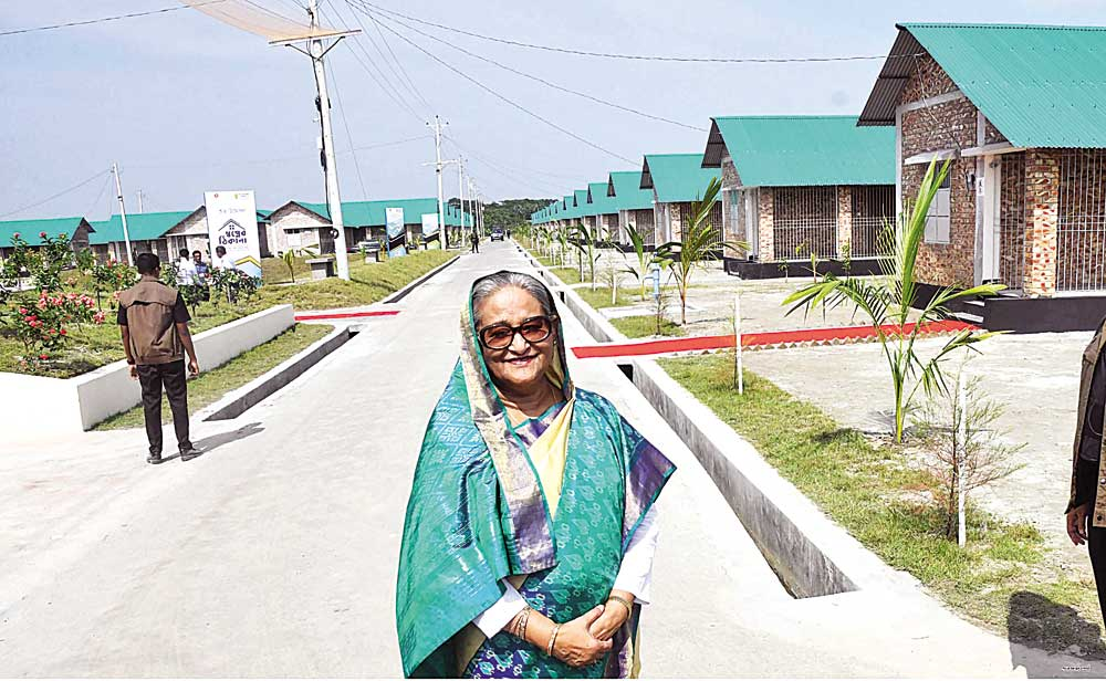 Prime Minister Sheikh Hasina visiting Payra Power Plant Rehabilitation Project at Kolapara in Patuakhali on Saturday. She visited newly constructed houses for the people affected in project area and handed over keys and registration papers to the rehabilitated families.photo : Focus bangla