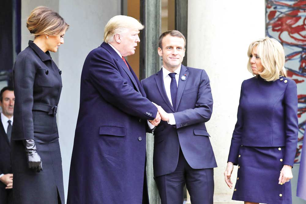 US President Donald Trump (2L) shakes hands with French President Emmanuel Macron (2R) next to US First Lady Melania Trump (L) and French President's wife Brigitte Macron at the Elysee Palace in Paris on November 10 following bilateral talks on the sidelines of commemorations marking the 100th anniversary of the 11 November 1918 armistice, ending World War I.	photo : AFP