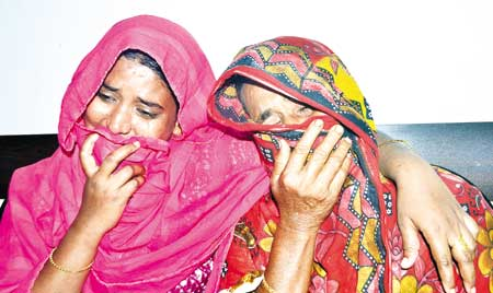 Relatives of two teenage boys, who were killed after a pick-up van ran them over during a clash allegedly between two factions of Awami League in Dhaka's Mohammadpur on Saturday, wail at Suhrawardy Medical College Hospital (SMCH). 	photo: Observer