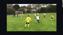 'Pushy' dad shoves son to save goal