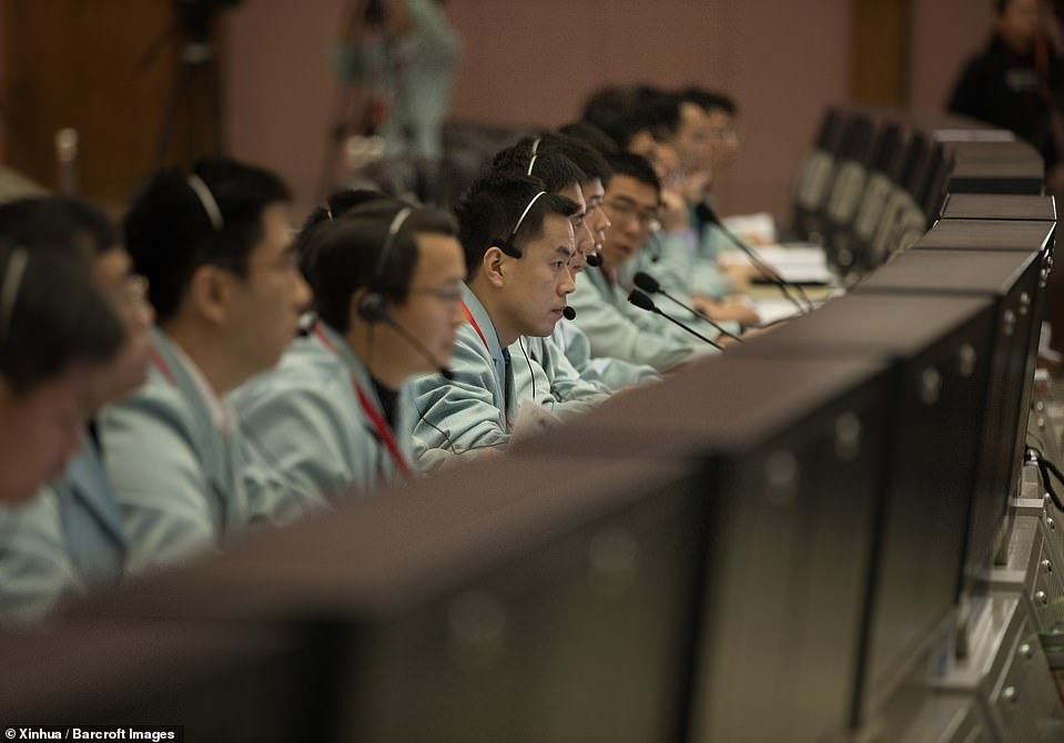 Technicians work at the Beijing Aerospace Control Center (BACC) in Beijingto on January 3 make the Chang'e-4 probe landing successful. It touched down on the far side of the moon and in the process became the first spacecraft soft-landing on the moon's uncharted 'dark side' which is never visible from Earth