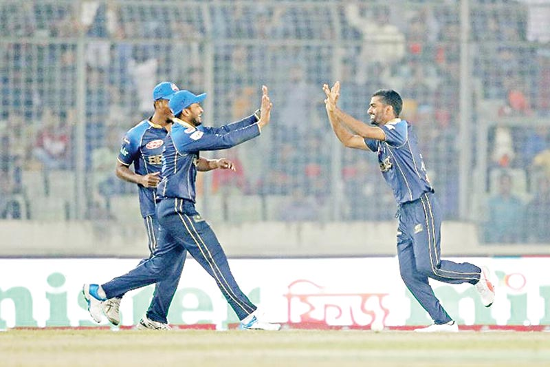 The debutant Aliss Al Islam of Dhaka Dynamites celebrating with Shakib Al Hasan during the 9th BPL match against Rangpur Riders at the Sher-e-Bangla National Cricket Stadium in Mirpur on Friday.	photo: BCB