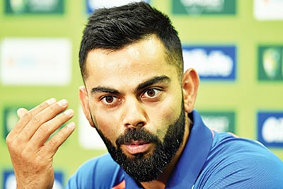 India's cricket captain Virat Kohli speaks during a press conference ahead of the first one-day international (ODI) match between India and Australia at the Sydney Cricket Ground in Sydney on January 11, 2019.	photo: AFP