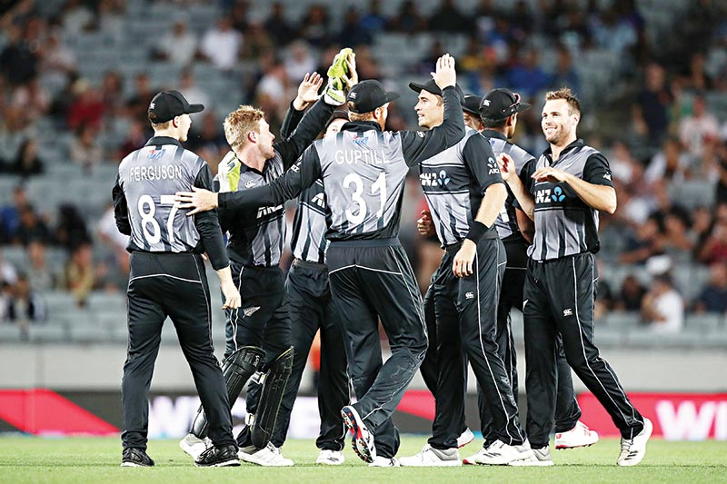 New Zealand's players celebrate taking a wicket during the twenty20 international cricket match between New Zealand and Sri Lanka at Eden Park in Auckland on January 11, 2019.photo: AFP