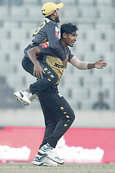 Rajshahi Kings' captain Mehidy Miraz frog jumps on Mustafizur Rahman after winning the match against Rangpur Riders in the 6th Bangladesh Premier League on Sunday at the Sher-e-Bangla National Cricket Stadium, Dhaka. 	photo: BCB