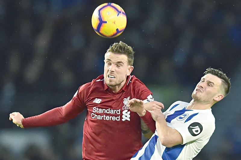 Liverpool's English midfielder Jordan Henderson (L) vies with Brighton's German midfielder Pascal Gross (R) during the English Premier League football match between Brighton and Hove Albion and Liverpool at the American Express Community Stadium in Brighton, southern England on Saturday. photo: AFP
