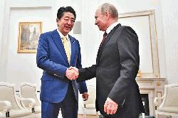 Putin, Abe hold summit to break island impasse