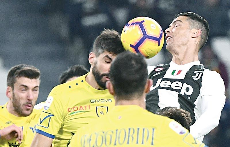 Ronaldo misses penalty but Juventus ease past Chievo