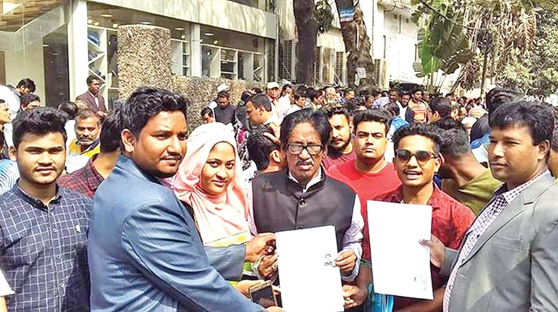 Noakhali District AL Organisational Secretary Omar Faruk Badshah collected his nomination paper for the chairman post from AL's Dhanmondi office on Wednesday. 	photo: Observer