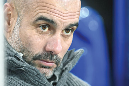 Manchester City's Spanish manager Pep Guardiola reacts as he sits in the dug out ahead of the English Premier League football match between Everton and Manchester City at Goodison Park in Liverpool, north west England on February 6, 2019.photo: AFP