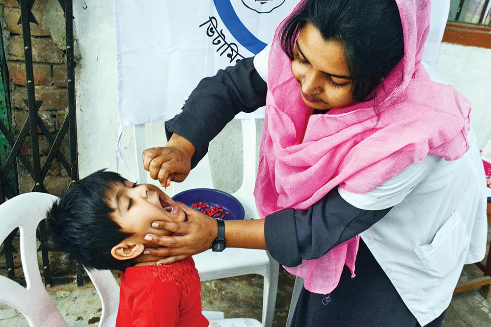 A child is being fed Vitamin 'A' plus capsule at Tejkonipara in the capital on Saturday. The national Vitamin 'A' plus campaign held across the country on the day aiming to feed the capsules to all children aged between six and 59 months.photo: Observer