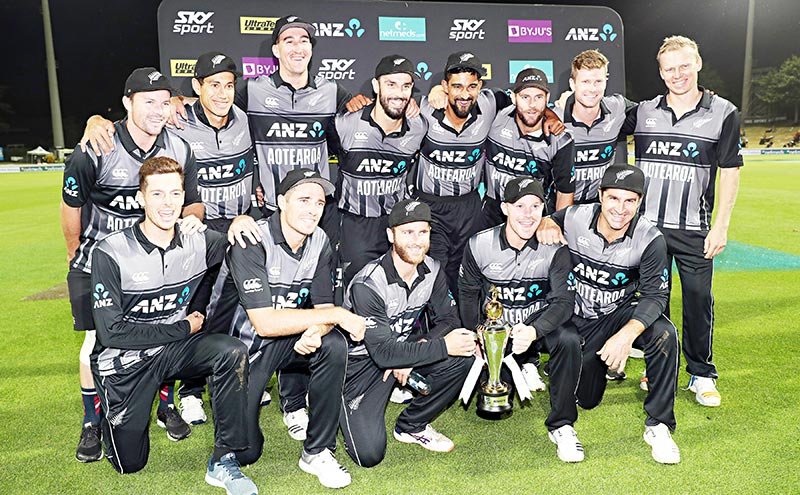 New Zealand players celebrate winning the third T20 international cricket match between New Zealand and India in Hamilton on Sunday.	photo: AFP