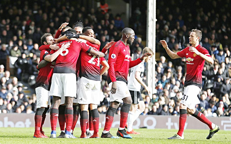 Manchester United's French midfielder Paul Pogba (2nd L) celebrates with teammates after scoring their third goal from the penalty spot during the English Premier League football match between Fulham and Manchester United at Craven Cottage in London on February 9, 2019.photo: AFP