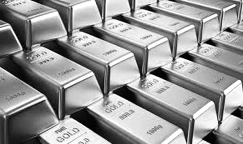 Gold slips as trade tensions buoy dollar