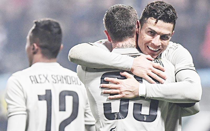 Juventus' Portuguese forward Cristiano Ronaldo (R) celebrates after scoring during the Italian Serie A football match Sassuolo vs Juventus on February 10, 2019 at the Mapei Stadium - Citta del Tricolore stadium in Reggio Emilia.photo: AFP