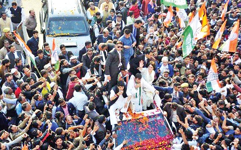 Priyanka Gandhi Vadra waves to large crowds from the top of a modified truck that wended its way through Lucknow on February 11 as she launches her campaign in Uttar Pradesh for the national election, days after her debut in            politics.photo : HINDUSTAN TIMES