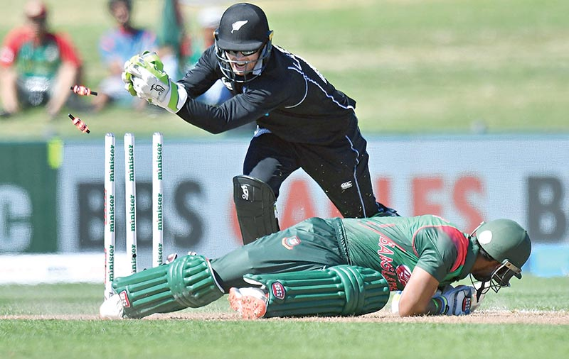 Bangladesh's Sabbir Rahman is stumped out by New Zealand's wicketkeeper Tom Latham (Back) during the first one-day international (ODI) cricket match between New Zealand and Bangladesh in Napier on Wednesday. photo: AFP