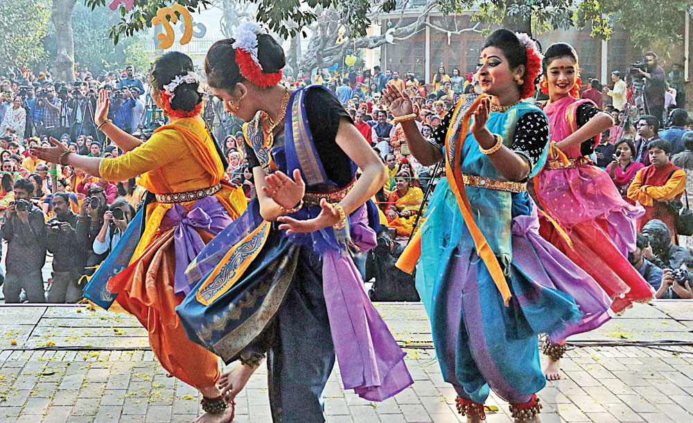 Spring is given a warm welcome with songs and dances at Bakultola of the Faculty of Fine Arts of Dhaka University on Wednesday, the first day of Bangali month of Falgun.	Photo: mukut mahmud