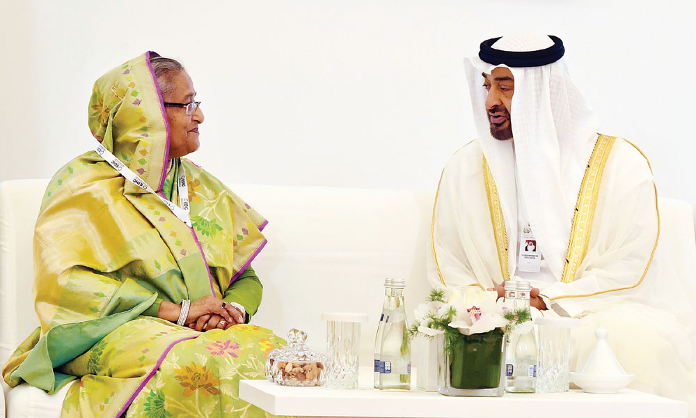 Crown Prince of Abu Dhabi Sheikh Mohamed bin Zayed bin Sultan Al-Nahyan welcomes Prime Minister Sheikh Hasina at the International Defence Exhibition (IDEX) organized by the UAE at the Abu Dhabi National Exhibition Centre on Sunday.  Photo: BSS