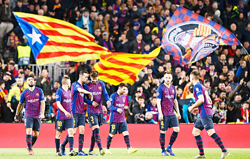 Barcelona's Spanish defender Gerard Pique (C) celebrates with teammates after scoring during the UEFA Champions League round of 16, second leg football match between FC Barcelona and Olympique Lyonnais at the Camp Nou stadium in Barcelona on March 13, 2019.	photo: AFP