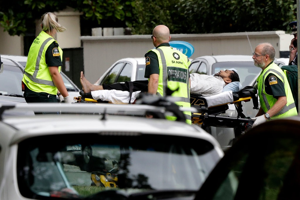 An injured man outside a mosque in central Christchurch, where the police reported an active shooter.CreditMark Baker/Associated Press