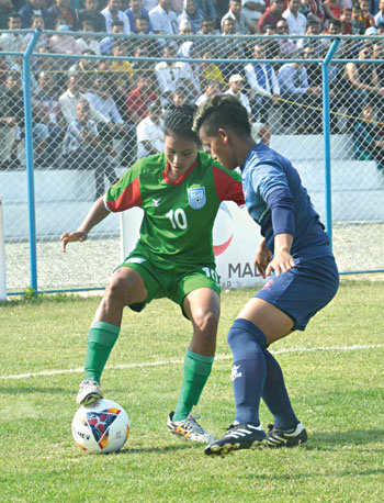 A moment of the match between Bangladesh and Nepal in the SAFF Women's Championship 2019 on Saturday at the Shaheed Rangashala Stadium in Biratnagar, Nepal.