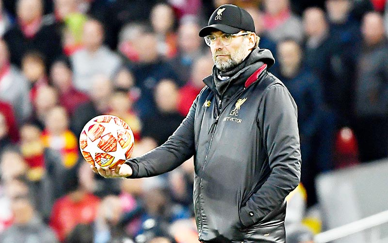 Liverpool's German manager Jurgen Klopp holds the ball as he looks on during the UEFA Champions League quarter-final, first leg football match between Liverpool and FC Porto at Anfield stadium in Liverpool, north-west England on April 9, 2019.photo: AFP
