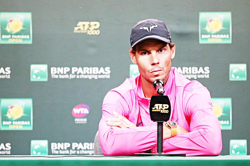 (FILES) In this file photo taken on March 16, 2019 Rafael Nadal of Spain speaks to members of the media after withdrawing from his men's singles semifinal match against Roger Federer of Switzerland due to a right knee injury on Day 13 of the BNP Paribas Open at the Indian Wells Tennis Garden in Indian Wells, California.	photo: AFP