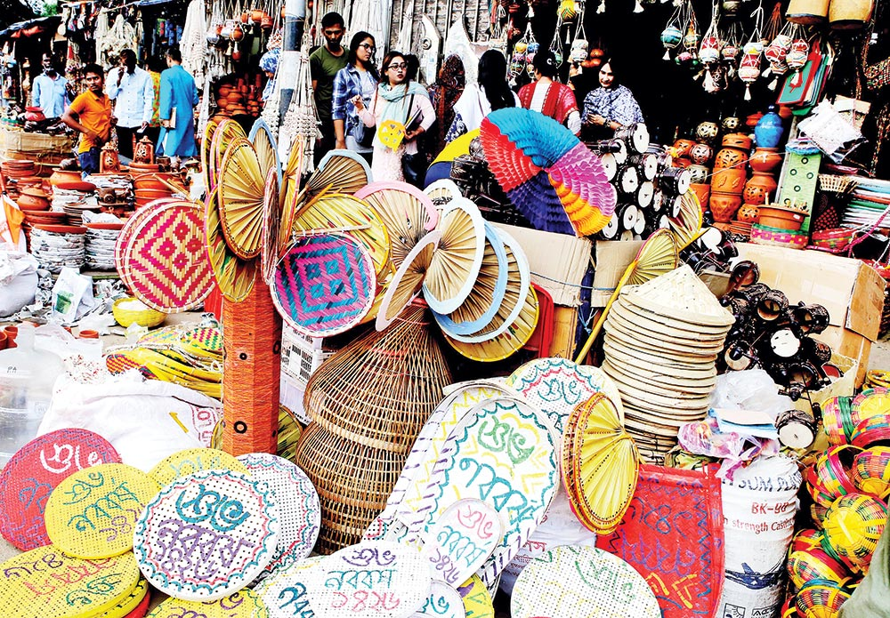 Artefacts are put on sale on Dhaka University campus on Saturday, the day before Pahela Baishakh, the first day of Bengali New Year. Baishakhi mela, is now an integral part of New Year celebrations.	photo: Observer