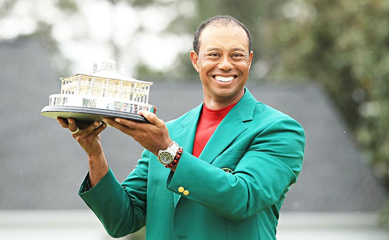Tiger Woods of the United States celebrates with the Masters Trophy during the Green Jacket Ceremony after winning the Masters at Augusta National Golf Club on April 14, 2019 in Augusta, Georgia.	photo: AFP