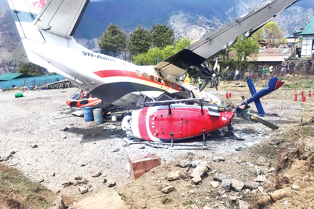 A Summit Air Let L-410 Turbolet aircraft bound for Kathmandu is seen after it hit two helicopters during takeoff at Lukla airport, the main gateway to the Everest region on April 14.	photo : AFP