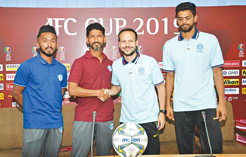 Coaches and skippers of Dhaka Abahani Ltd (R) and Minerva Punjab Football Club (L) ahead of their match of AFC Cup group stage on Tuesday at the BFF House in Dhaka. photo: BFF