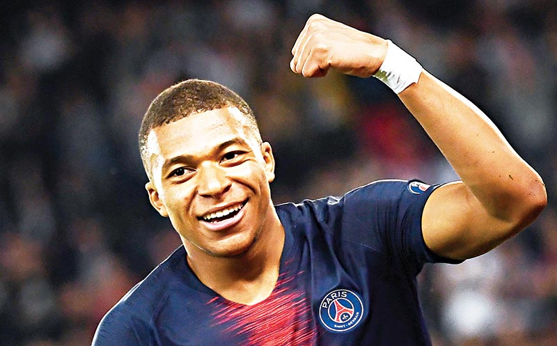Paris Saint-Germain's French forward Kylian Mbappe celebrates after scoring a goal during the French L1 football match between Paris Saint-Germain (PSG) and Monaco (ASM) on April 21, 2019 at the Parc des Princes stadium in Paris. 	photo: AFP