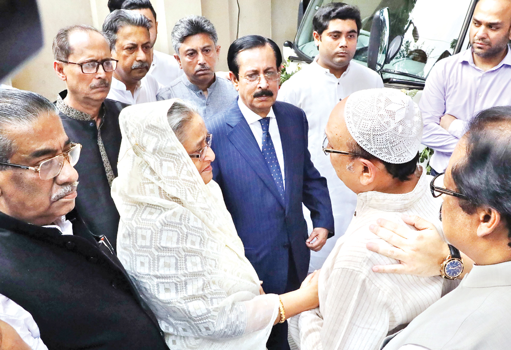 Prime Minister Sheikh Hasina consoling family members of Zayan Chowdhury, who was killed in a blast at a hotel in Colombo, capital of Sri Lanka, at Awami League presidium member and Zayan's grandfather Sheikh Fazlul Karim Selim's residence at Banani in the capital on Wednesday. Photo: BSS