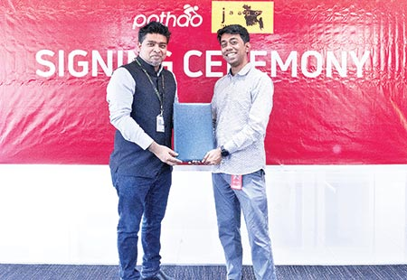 Pathao CEO Hussain M Elius and Jaago Founder Korvi Rakshand pose for photograph after signing a memorandum of understanding in Dhaka on Sunday.