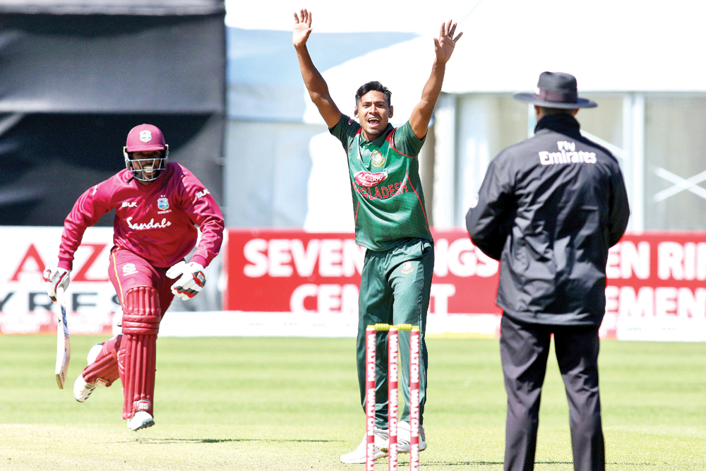 Bangladesh's Mustafizur Rahman (C) appeals successfully for LBW (leg before wicket) against West Indies' Raymon Reifer (L) during the Tri-Nation Series, one day international between Bangladesh and West Indies  Malahide cricket club, in Dublin on May 13. West Indies scored 247 for 9 from their 50 overs. 	Photo: AFP