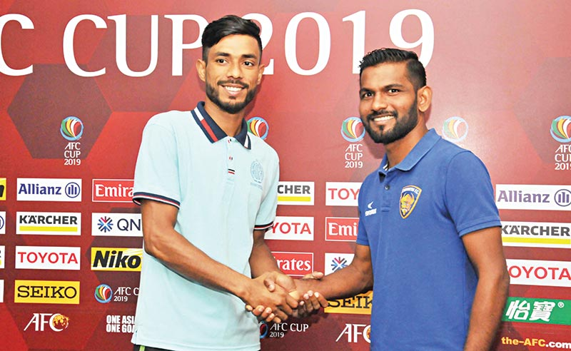 The skippers of Dhaka Abahani (L) and Chennaiyin Football Club (R)  shaking hands before their group encounter of AFC Cup group stage on Wednesday.	photo: BFF