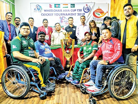 Four captains pose with the trophy of the first ever Wheelchair Asia Cup Cricket 2019 on Tuesday.	photo: Courtesy