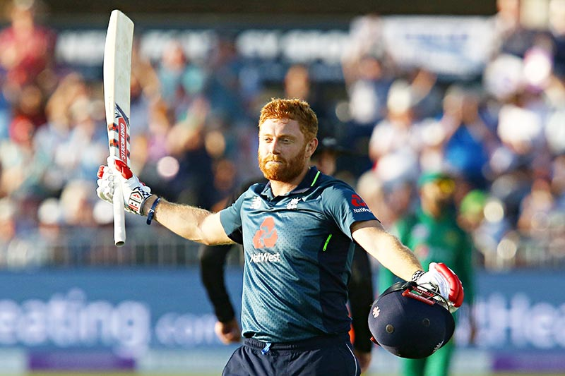 England's Jonny Bairstow celebrates his century during the third One Day International (ODI) cricket match between England and Pakistan at The Bristol County Ground in Bristol on May 14, 2019.