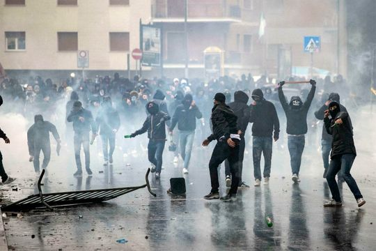 Lazio fans clash with police prior to the Italian Cup final on Wednesday. (Photo: Massimo Percossi, AP)