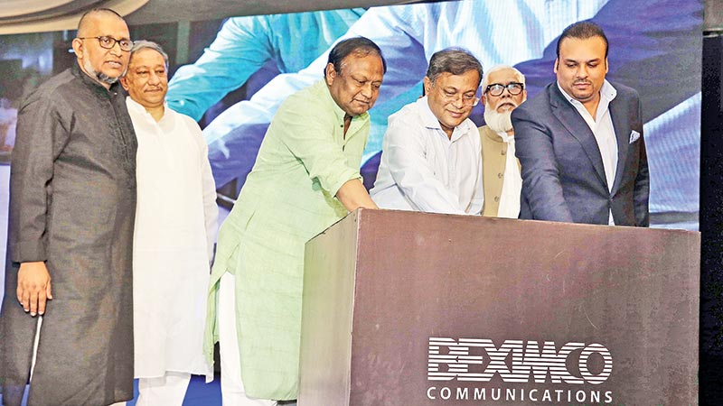Information Minister Dr. Hasan Mahmud, MP and Commerce Minister Tipu Munshi, MP flanked by other dignitaries, jointly launch Akash DTH of Beximco Communications at The Westin Dhaka hotel in the capital on Thursday.