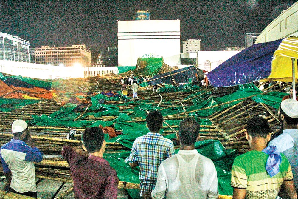 A canopy set up for iftar party on the premises of Baitul Mukarram National Mosque collapsed during storm on Friday evening, killing one person and injuring 22 others.photo : Observer