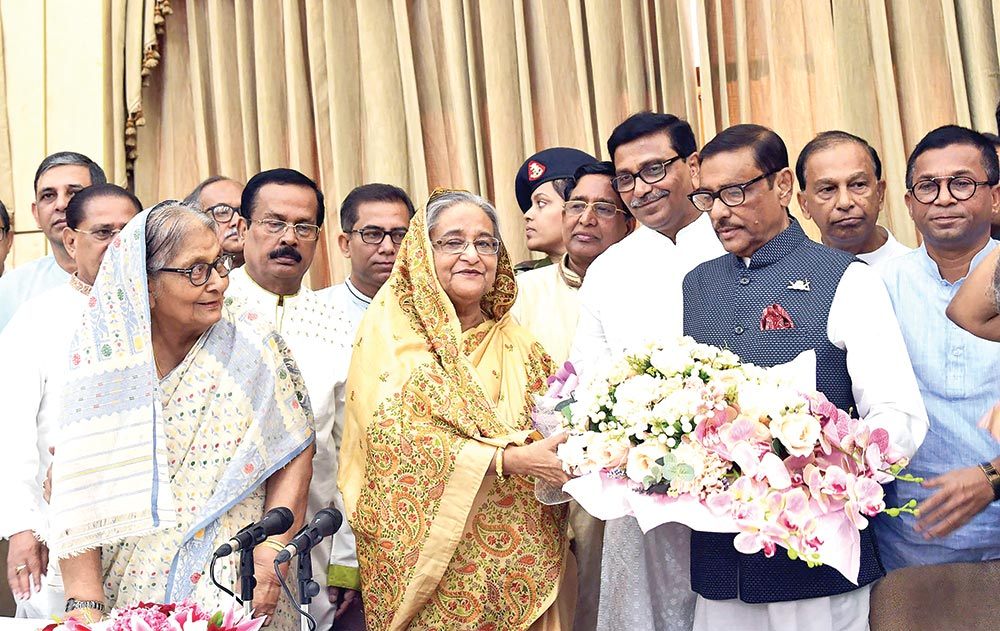 Leaders and activists of Awami League and its associated bodies greet Prime Minister Sheikh Hasina at Ganobhaban in the capital on Friday on the occasion of her Homecoming Day.	photo: pid