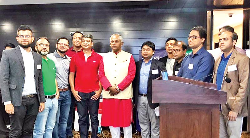 Robi Managing Director and CEO, Mahtab Uddin Ahmed flanked by participants, attends the Demo Day of Robi's employee entrepreneurship programme, r-ventures, as the chief guest, in Dhaka recently.