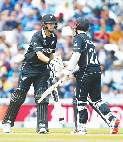 Ross Taylor (L) congratulates Kane Williamson after he reaches 50 runs not out during the 2019 Cricket World Cup warm up match between India and New Zealand at The Oval in London on May 25, 2019.photo: AFP