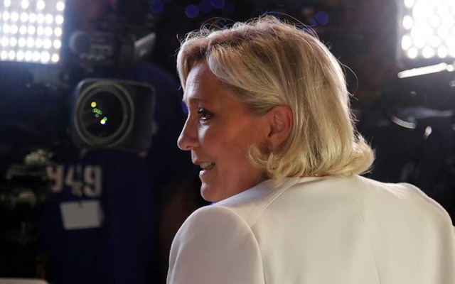 French far-right National Rally (Rassemblement National) party leader Marine Le Pen talks to the media after the first results in Paris. Reuters