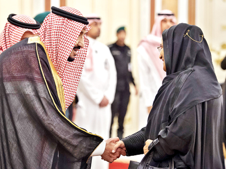 This handout photo released by the Saudi Royal Palace shows King Salman bin Abdulaziz (L) of Saudi Arabia welcoming Bangladesh Prime Minister Sheikh Hasina at a summit meeting of the 57-member Organization of Islamic Cooperation (OIC) in Makkah in the early hours of June 1.Photo: AFP